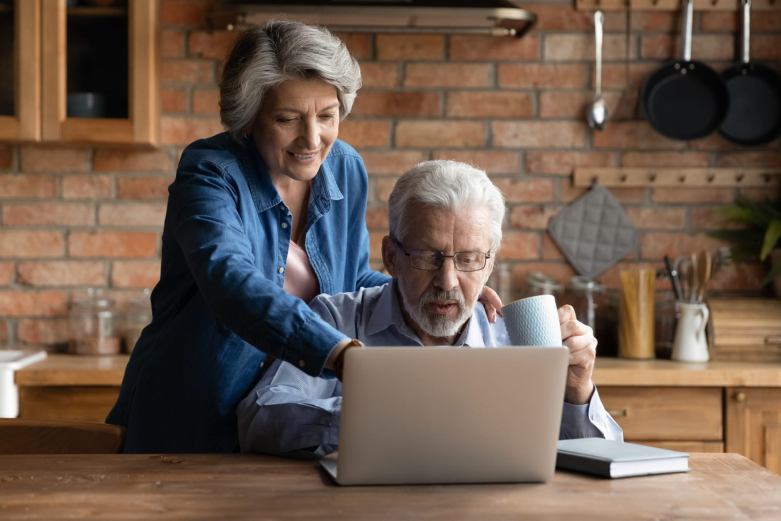 mature couple researching misconceptions about hearing loss